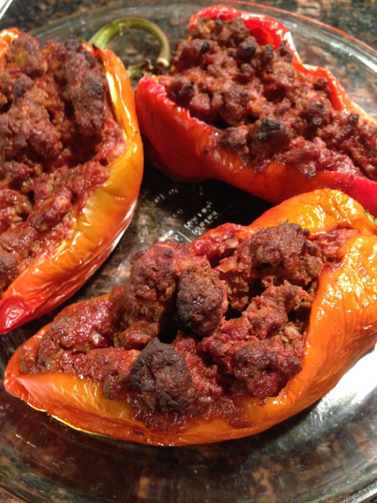 Farmer's market peppers stuffed with grass-fed ground beef, onions, garlic, tomatoes, and diced peppers.